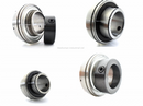 INSERTS WITH CROWNED OUTER RACE